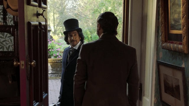 a screencap of jafar (played by naveen andrews) meeting alice's father, edwin (played by john prowse)