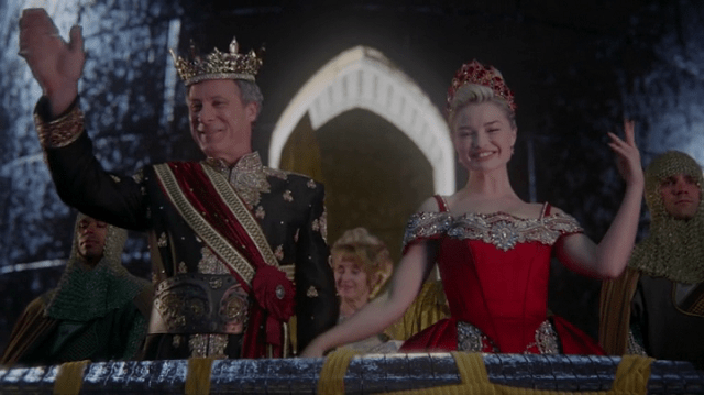 a screencap of anastasia (played by emma rigby) waving with the king (played by garwin sanford)
