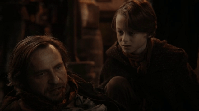 a screencap of rumpelstiltskin's father (played by stephen lord) and a young rumpelstiltskin (played by wyatt oleff)