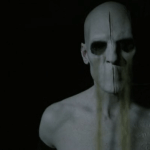 a screencap of the sandman or ro'henhronteys (played by marti matuli) with sand running from his eyes