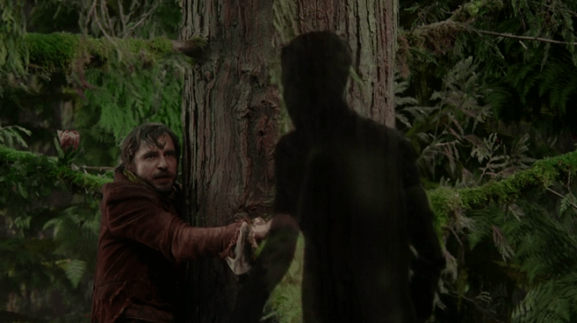 a screencap of rumpelstiltskin's father (played by stephen lord) meeting the shadow