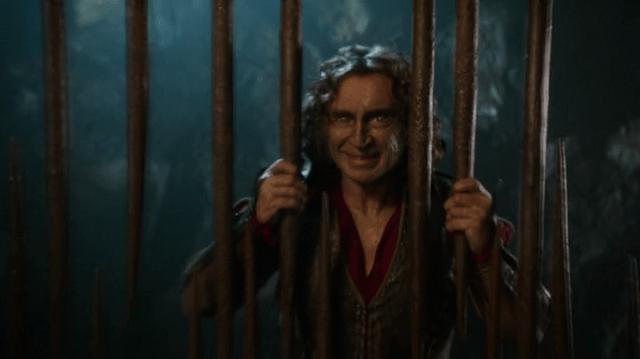 a screencap of rumpelstiltskin (played by robert carlyle) imprisoned