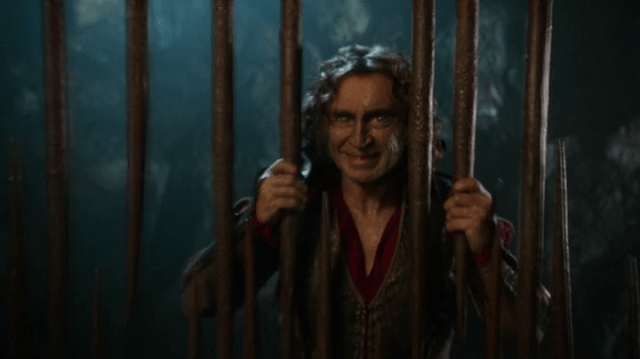 a screencap of rumpelstiltskin (played by robert carlyle) imprisoned