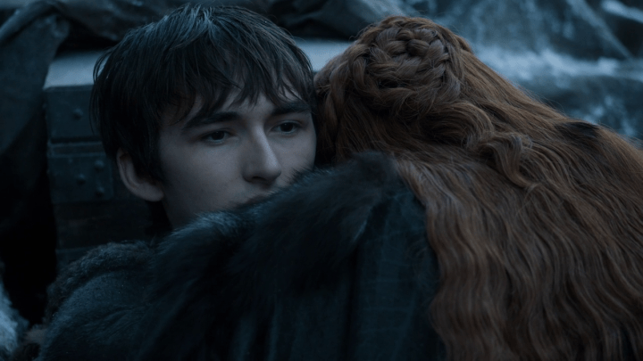 sansa stark (played by sophie turner) hugs bran stark (played by isaac hempstead wright)