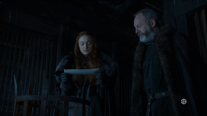 sansa stark (played by sophie turner) and davos seaworth (played by liam cunningham) read a message from tyrion