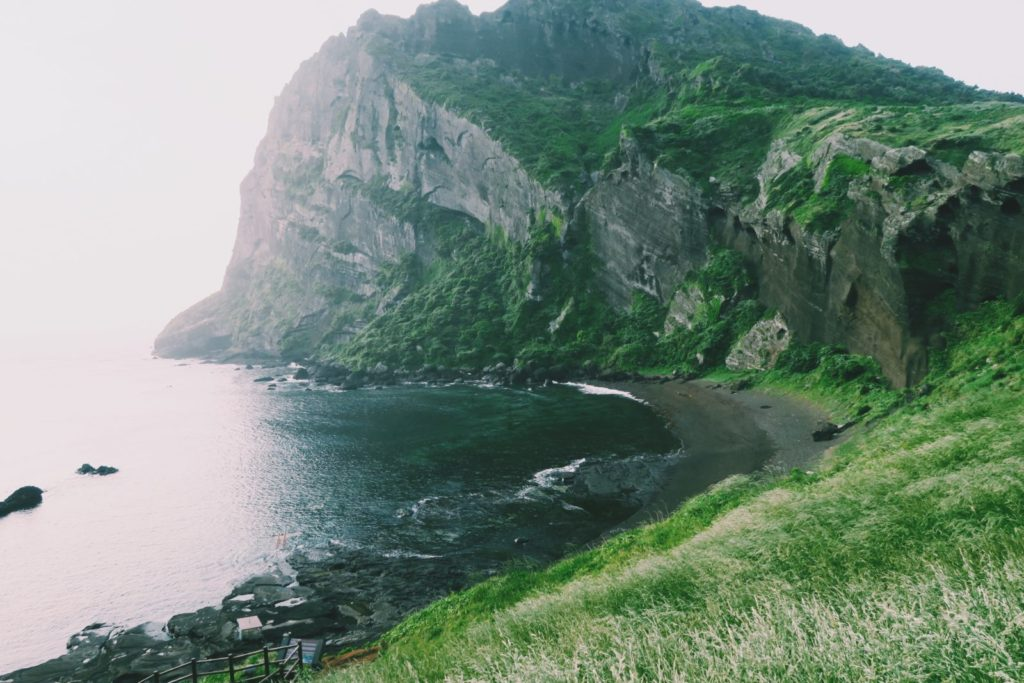 Sunrise Peak and a black sand beach on Jeju Island