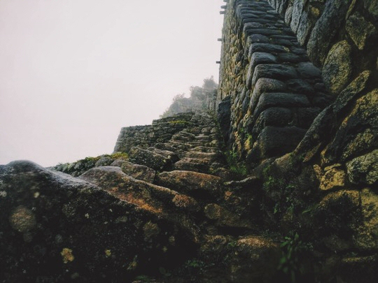 Stairs climbing down Huayna Picchu in Peru, smothered in fog