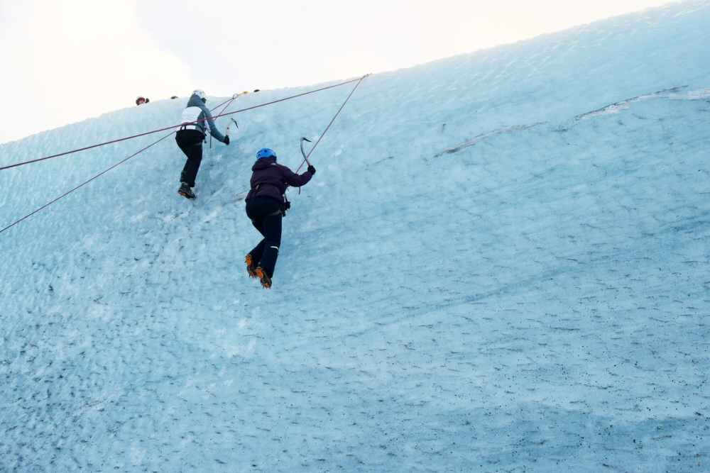 Two Climbers Ice Climbing in Iceland: Top Iceland Attractions
