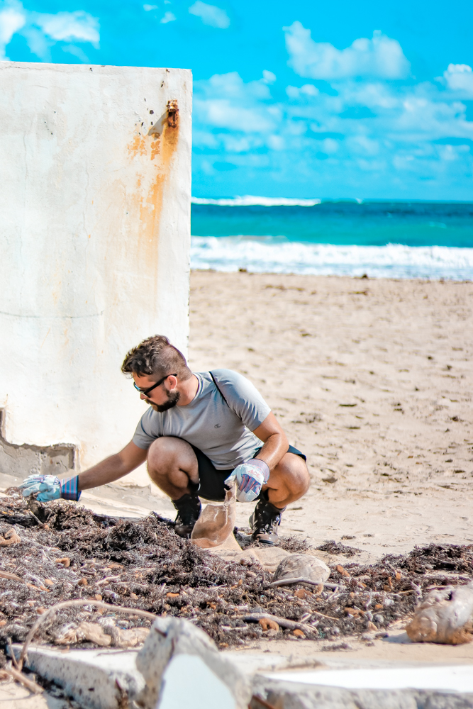 Beach cleanup in St Maarten as part of the Fathom impact cruise