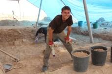 Jon Ross learning how to sweep dirt floors, Area E 2013