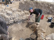 Annie Brown excavating the round burned installation