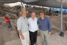 Haskel Greenfield, Prof. Moshe Kaveh (Past-President of Bar-Ilan University), and Arean Maier standing in front of Area E, 2013