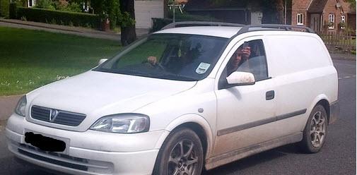 Cars taking photos of Muslim female