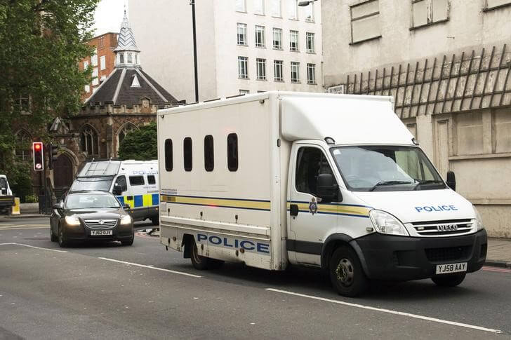 Police vehicles escort a prison van as it arrives at Westminster Magistrates' Court in London, Britain June 18, 2016.   Anthony Devlin/Press Association via REUTERS