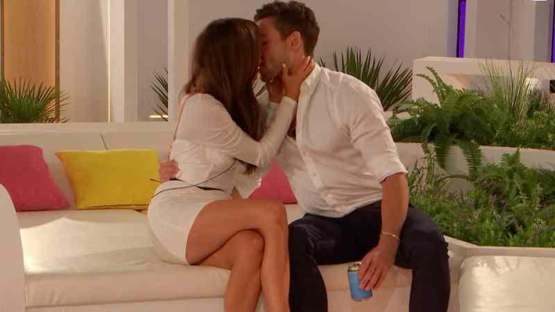 Tom and Maura kiss.
