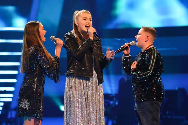 Lucy, Aimee and Liam perform.