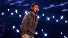 Joshua performs.