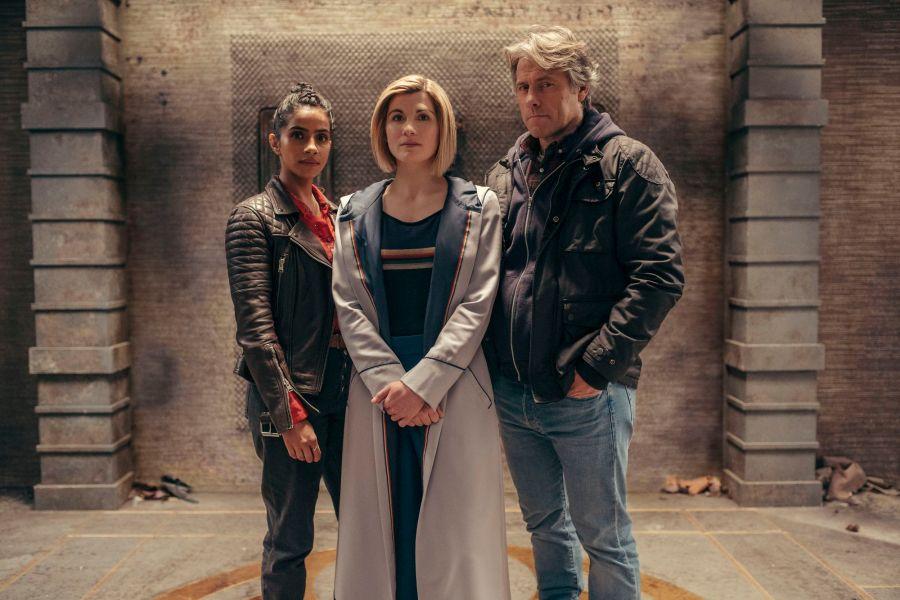 Doctor Who: Yaz (MANDIP GILL), The Doctor (JODIE WHITTAKER), Dan (JOHN BISHOP) - (C) BBC Studios - Photographer: James Pardon