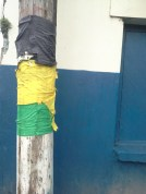 Jamaica flag colours on lamp post
