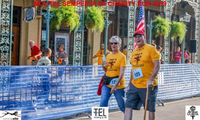 2019-TEL-MCL-Semper-Fi-5k-Charity-Run-for-the-Children-Fun-Run-Pensacola-FL_Don-Roe-and-spouse