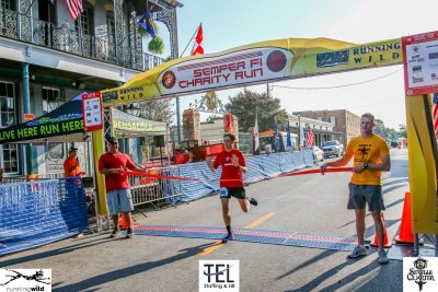 2019-TEL-MCL-Semper-Fi-5k-Charity-Run-for-the-Children-Fun-Run-Pensacola-FL_crossing-the-finish-line-first