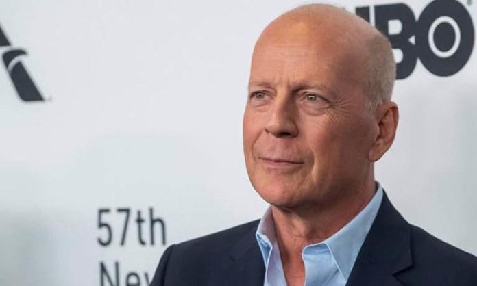 Bruce Willis slips into his 'Armageddon' spacesuit
