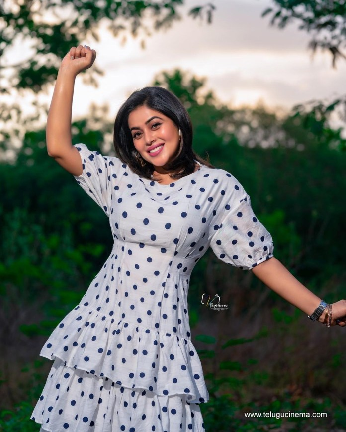 Poorna in a polka dotted dress