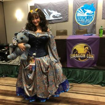 Alethea Kontis with the Marriott carpet bear wearing a Marriot carpet princess dress