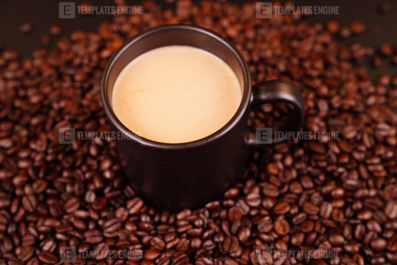 Cup of coffee with whole beans stock photo