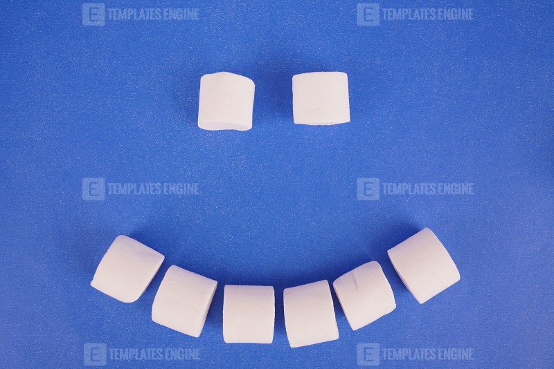 Emoji from sweet marshmallow on blue background