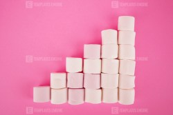Growing bar chart with marshmallow on pink background