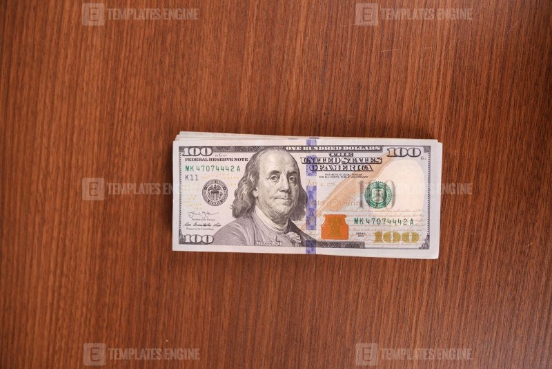 Dollar banknotes on wooden surface