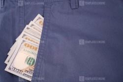 Dollars in pocket stock image