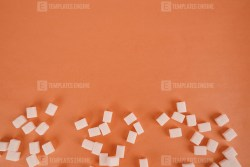 Lump sugar on orange stock photo
