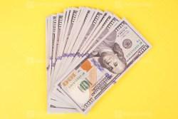 Many hundred US dollars on yellow