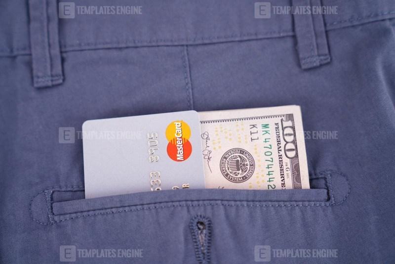Mastercard and dollars in pocket