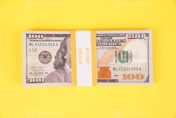Stack of Ten Thousand dollars on yellow