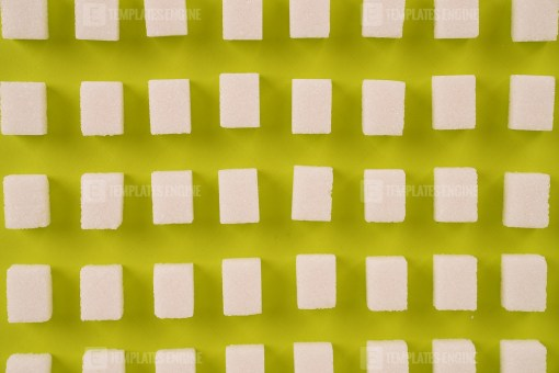 Sugar lumps pattern on green background