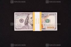 Ten Thousand dollars on black fabric