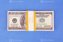 Ten thousand dollars on blue background