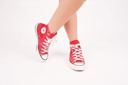 Young Female Wears Red All Star Sneakers