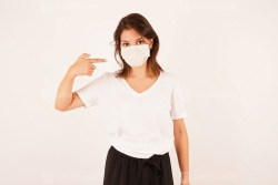 Caucasian woman wearing a surgical mask