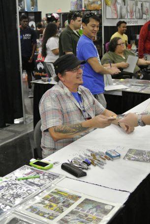 Kevin Eastman signs fan's comic | Photo Credit: Danniel Slade