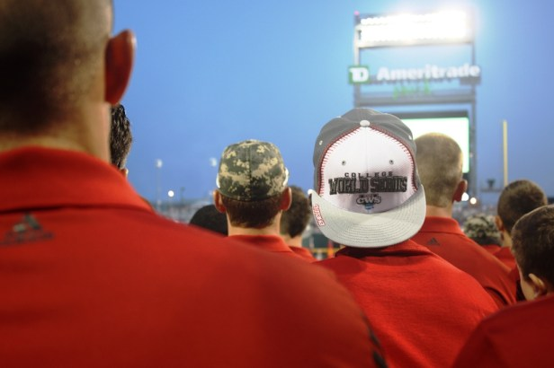 Texas Tech looks on as parachutes drop in the eight team flags.