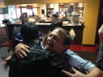 Goodbye, multimedia -- Rob, Christian, and Justin share one last hug.