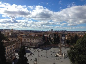 View from the top of the Piazza del Popolo on a sunny day.
