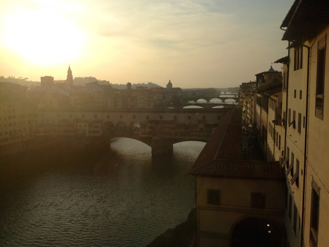The Ponte Vecchio at sunset taken from inside the Uffizzi Gallery.