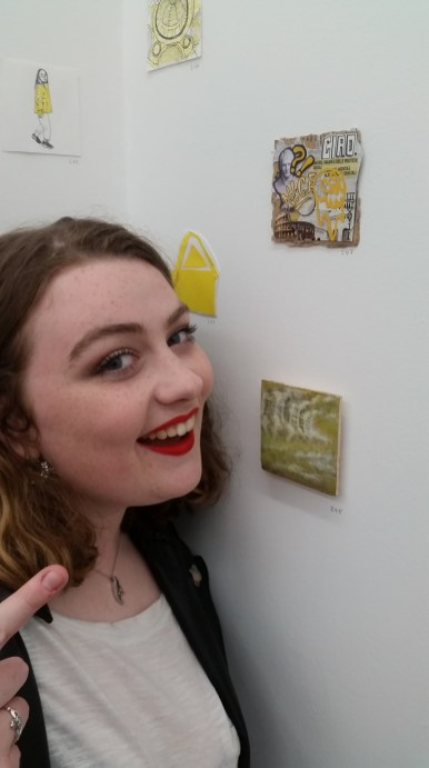 Pictured here geeking out about having work in a gallery for the first time in years, even if it was for class