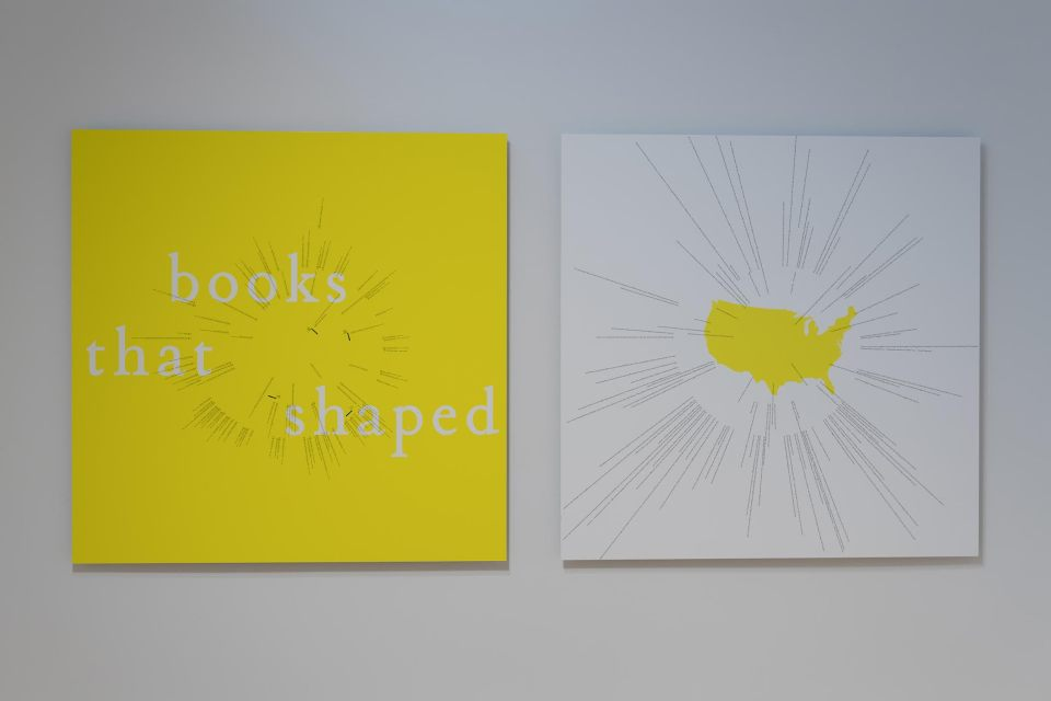 "Heather Corcoran. 'Books That Shaped America', 2016 (left) and Words That Shaped America, 2016 (right). Digital prints, each 40 x 40"". Installation view."