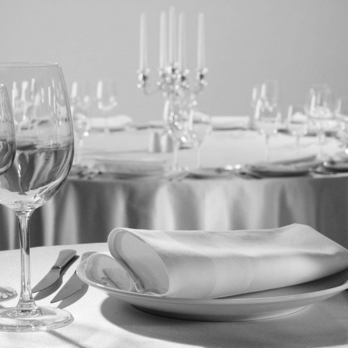 Served table in the restaurant - clean glasses, plates, forks, napkin